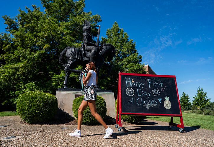 A student returns to Bellarmine's campus on the first day of classes, fall 2020.