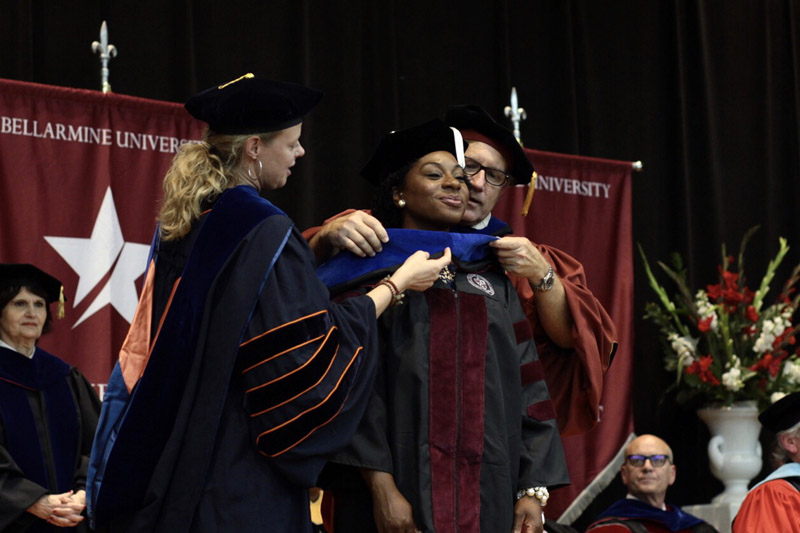 Doctoral student being hooded