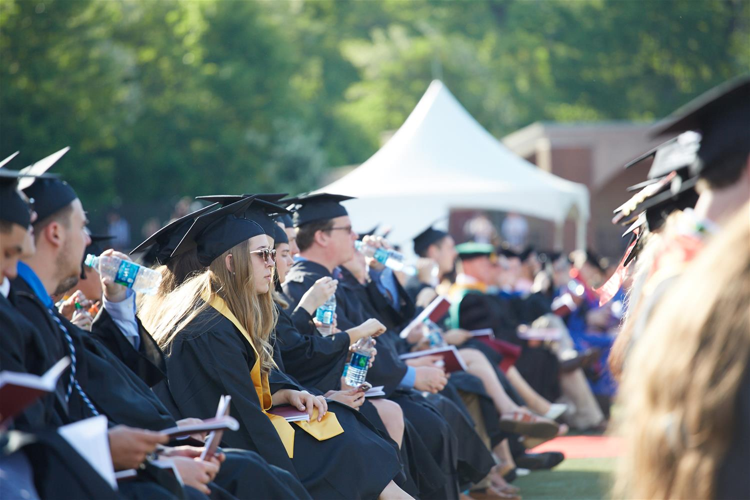 Students listening to Commencement speakers