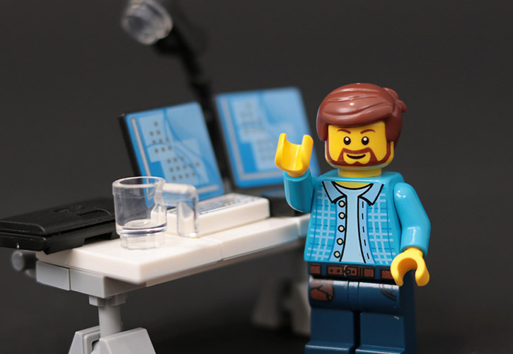 Lego figurine at a workstation