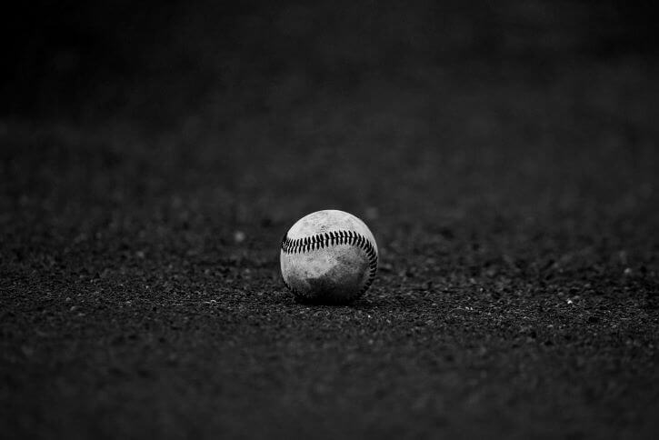 A lone baseball lies on the field