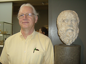 Dr. Fenton posing with a sculpture